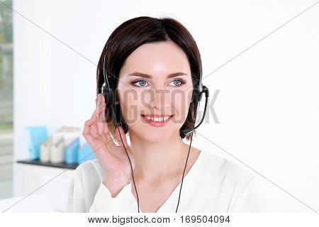 Young beautiful technical support dispatcher working, closeup