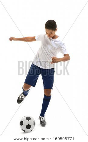 African American boy playing football on white background