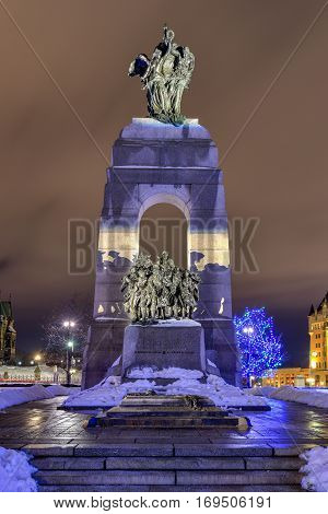 The National War Memorial is a tall granite cenotaph with accreted bronze sculptures that stands in Confederation Square in Ottawa Ontario Canada.