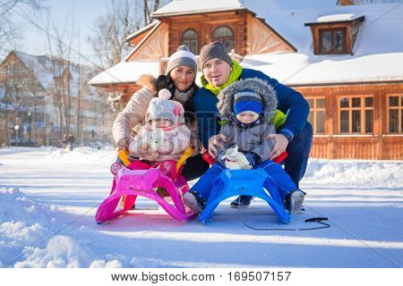 Winter portrait of happy family with toddler twins