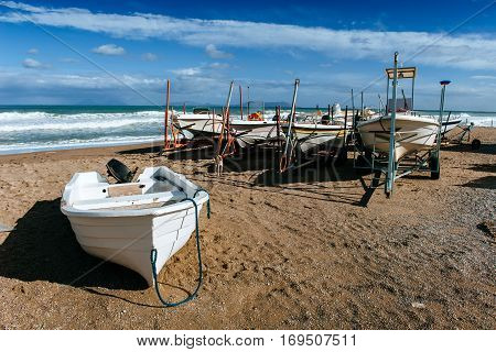 boat ashore on the sand, Mediterranean Sea, sunny day