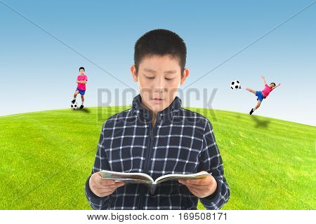 Asian boy reading a book and imagine to go out to play soccer