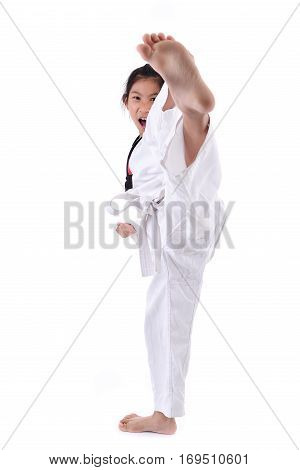 Asian child girl stretching leg in martial arts practice training kick and attack in plastic action like karate kid isolated on white background