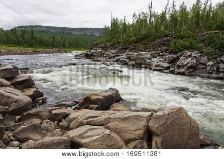 Big river of Eastern Siberia. Rapids on the river quickly. Krasnoyarsk region.
