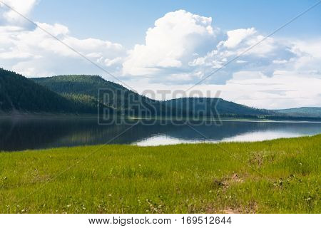 Landscape with clouds over water. Tunguska river. Krasnoyarsk territory.
