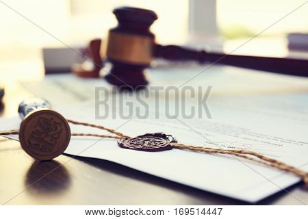 Old notarial wax seal and stamp on judicial table