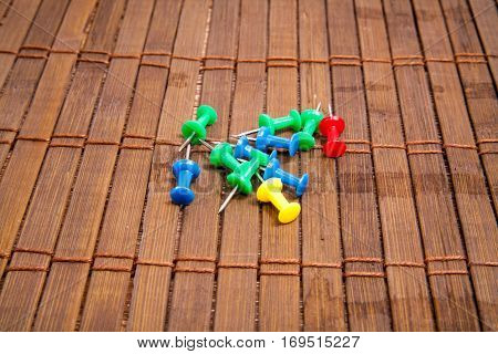 color push pin on wooden board. stock image