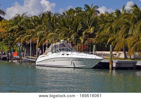 A cabin cruiser moored on Sunset Island and exclusive gated community in the south beach section of miami beach,florida