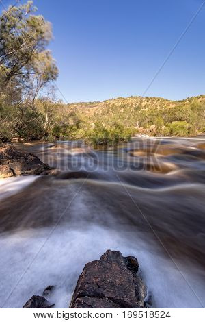 Bells Rapids in the Swan Valley. Perth, Western Australia. A walk bridge spanning the Swan River over the white water rapids make this an exciting viewing spot during the Avon Descent.