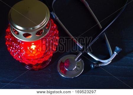 Medical error mistake concept with stethoscope and cemetery candle