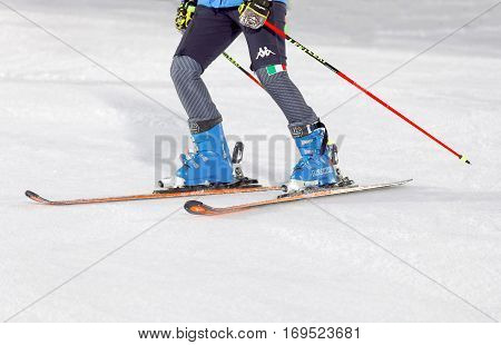 STOCKHOLM SWEDEN - JAN 31 2017: Closeup of the skiis and legs of officials inspecting the ski used for parallel slalom at the Alpine Audi FIS Ski World Cup. January 31 2017 Stockholm Sweden
