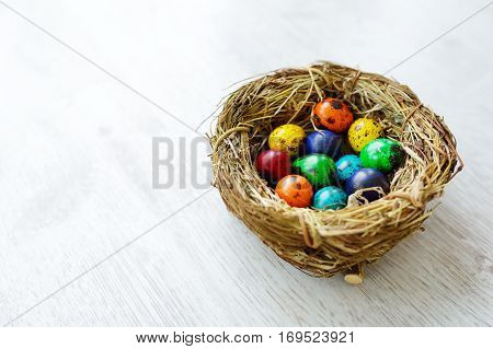 A Nest With Colored Easter Eggs At Home On Easter Day