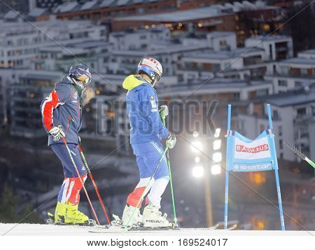 STOCKHOLM SWEDEN - JAN 31 2017: Mattas Hargin inspecting the ski used for parallel slalom the city in the background; at the Alpine Audi FIS Ski World Cup. January 31 2017 Stockholm Sweden