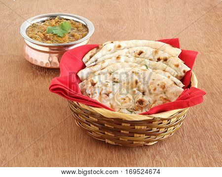 Indian food kulcha, a type of traditional and popular bread, and vegetable curry.