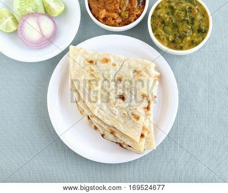 Indian food naan, a type of traditional and popular bread, and vegetable curries.