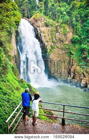 The Couple At Haew Narok (chasm Of Hell) Waterfall, Kao Yai National Park, Thailand