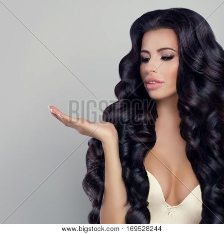 Beautiful Woman Showing with black hair her Empty Hand