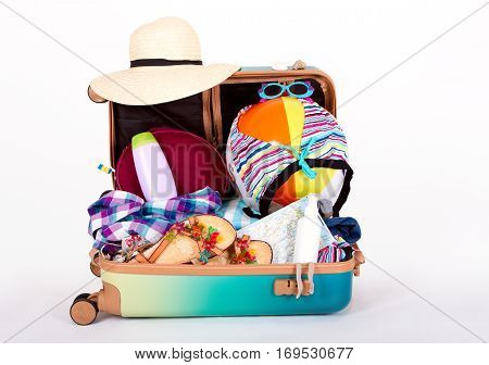 suitcase ready for vacation filled with things for a trip to the sea