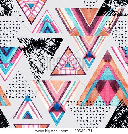 Abstract watercolor triangle seamless pattern in bright colors. Triangles with aztec ornament doodle watercolor grunge textures. Background with ethnic tribal elements. Hand painted illustration