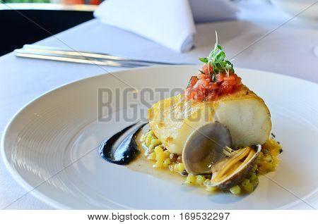 Seared Atlantic Cod, Fregola Sarda, Black Garlic & Vongole