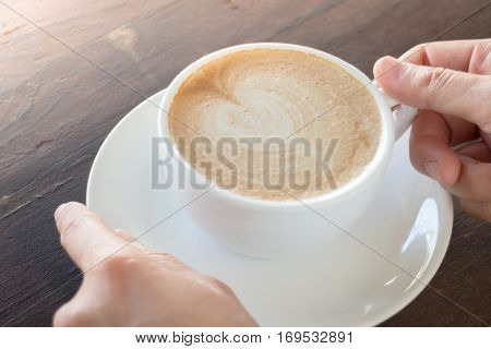 Hot cup of coffee latte stock photo