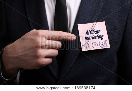 Business, Technology, Internet And Network Concept. Young Businessman Shows The Word: Affiliate Mark
