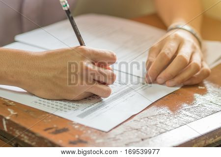 students writing on a paper for exams and admissions in high school Thailand