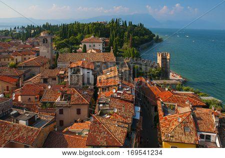 Aerial View of peninsula with rooftops of Sirmione town from the Scaliger Castle over the Garda Lake Italy
