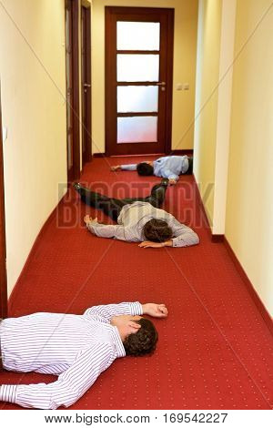 Three businessman lying down in office