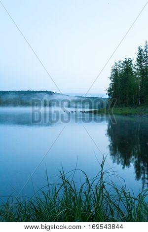 Landscape on the Bahta river. Foggy morning. Eastern Siberia, Russia