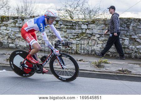 Conflans-Sainte-HonorineFrance-March 62016: The French cyclist Jerome Coppel of IAM Cycling Team riding during the prologue stage of Paris-Nice 2016.