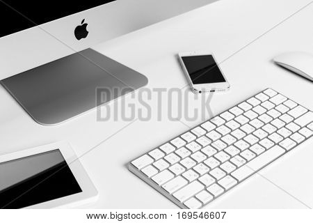 UKRAINE, RIVNE, January 2, 2017. Apple Computer iMac 27 retina display 5K keyboard and magic mouse and iphone, ipad, on white table.