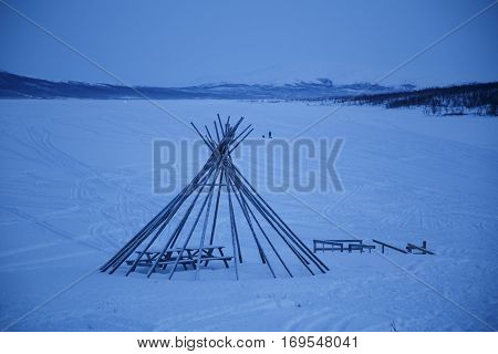 Wigwam in winter frosen lake in north of Finland