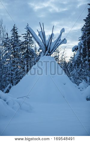 Wigwam in winter forest at North Finland