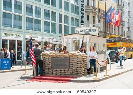 BERLIN, GERMANY- May 18, 2016 : Checkpoint Charlie. Former bordercross on May 18, 2016. Berlin Wall crossing point between East and West Berlin during the Cold War. BERLIN, GERMANY