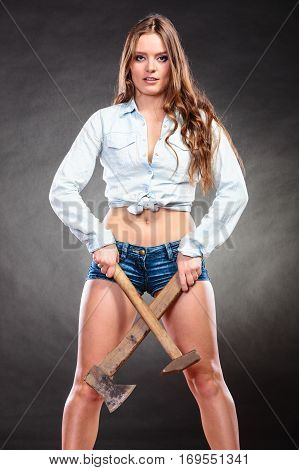 Sexy Alluring Woman Holding Hammer And Axe.