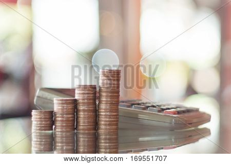 Stack of coins calculator money plan natural blurr background