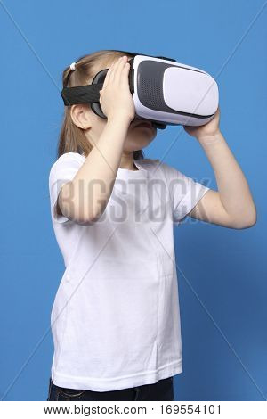 girl wore glasses virtual reality VR. isolated on blue background