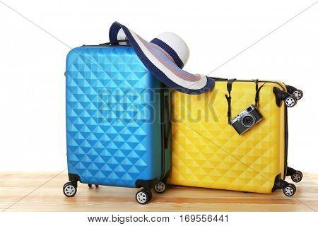 Colourful traveler cases on white background