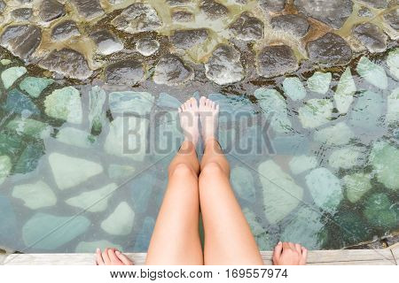 Women legs enjoys with hot springs water