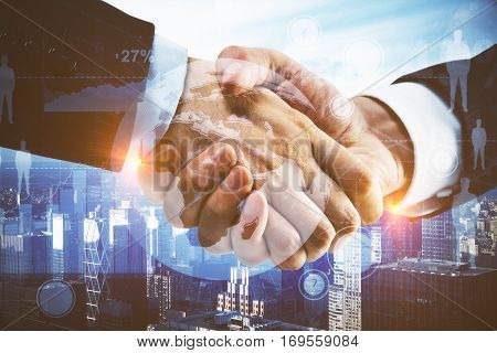Close up of handshake with creative digital charts terrestrial globe and HR icons on city background. Partnership concept