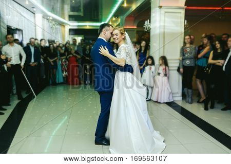 People Watch A Joyful Wedding Couple Dancing At The First Time