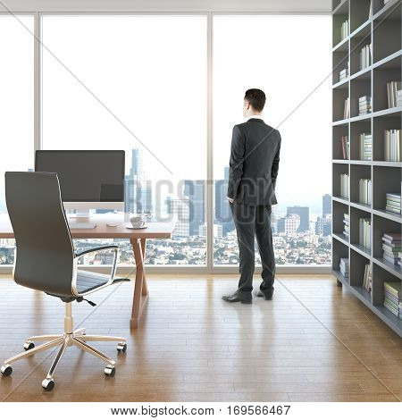 Businessman in modern interior with blank computer on desk book case and panoramic window with city view. Mock up 3D Rendering