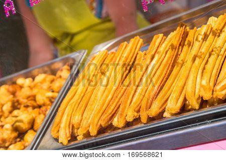 closeup on fresh spanish churros in a shop