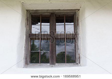 an old window of a farmers house