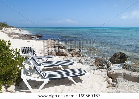 Empty chairs on Grand Turk island beach (Turks & Caicos).