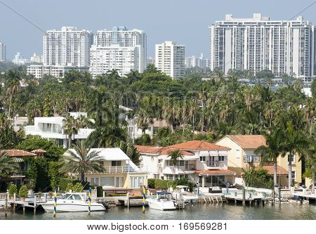 The view of Palm Island houses with Miami Beach buildings in a background (Florida).