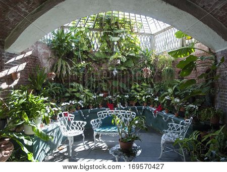The room surrounded by tropical plants and decorated for Christmas in Key West town botanical garden (Florida).