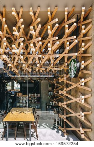 DAZAIFU JAPAN - FEB 20 2012 : Starbuck Coffee shop front display design by Kengo Kuma and associates