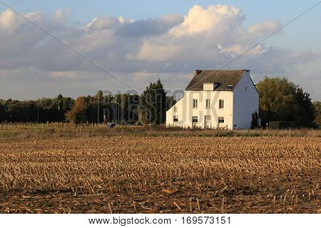 White house in the field, farm house in Belgia